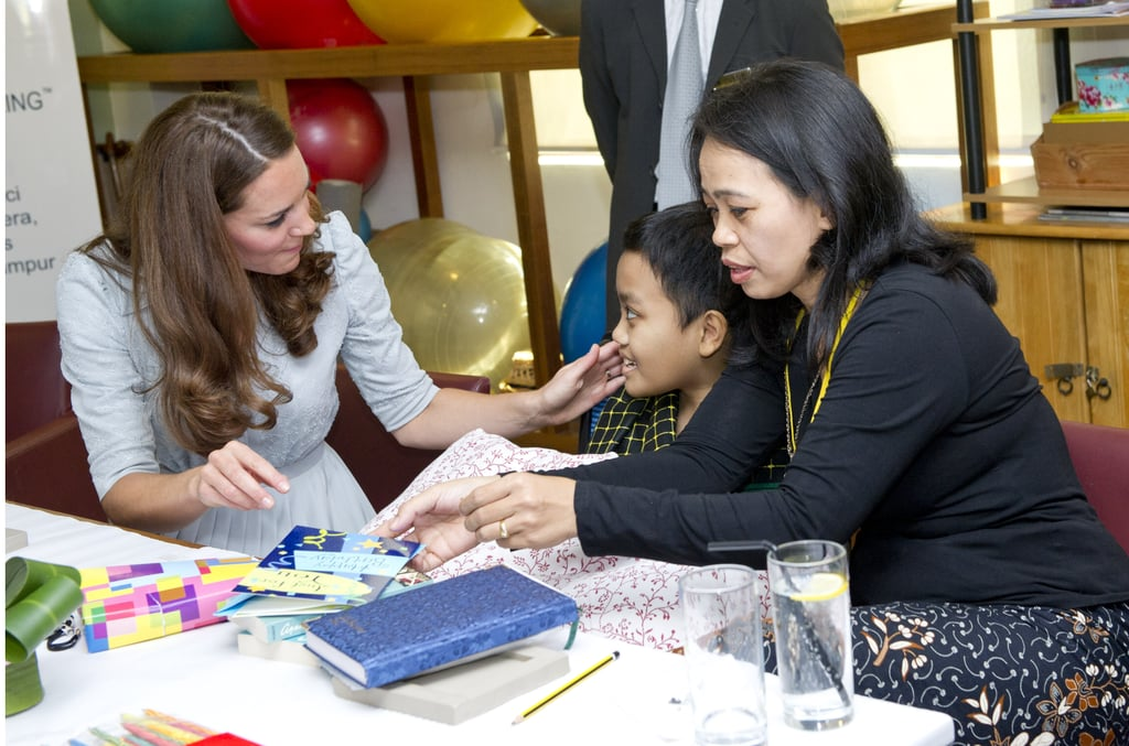 Kate Middleton visited with children at a hospice in Malaysia.