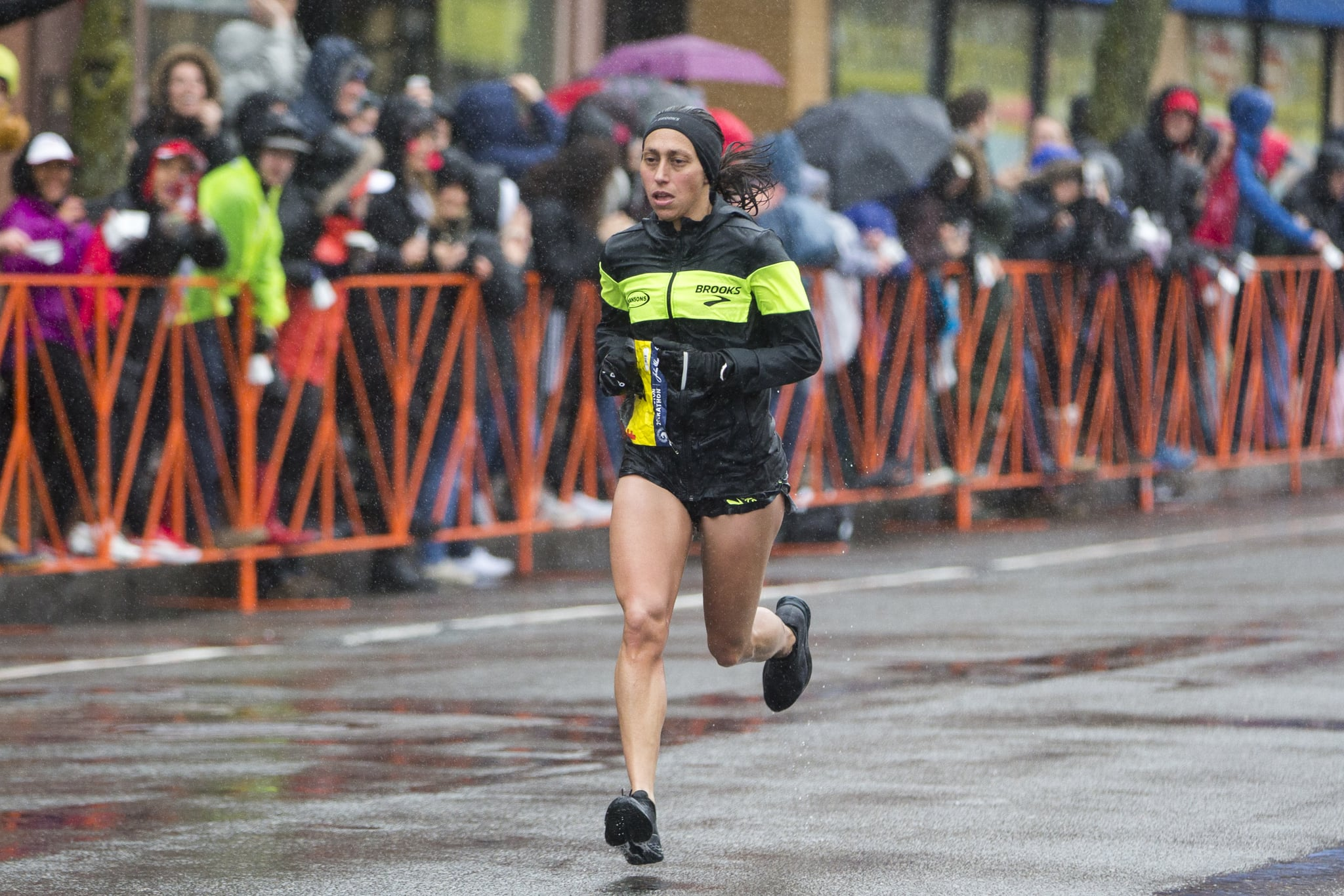 BROOKLINE, MA - APRIL 16:  Desiree Linden approaches the 24 mile marker of the 2018 Boston Marathon on April 16, 2018 in Brookline, Massachusetts. Linden became the first American winner since 1985 with an unofficial time of 2:39:54. (Photo by Scott Eisen/Getty Images)