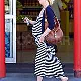 Pregnant January Jones shops in a striped dress.