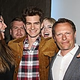 Emma hilariously photobombed Andrew at the afterparty for the play Bull's opening night in May 2013.