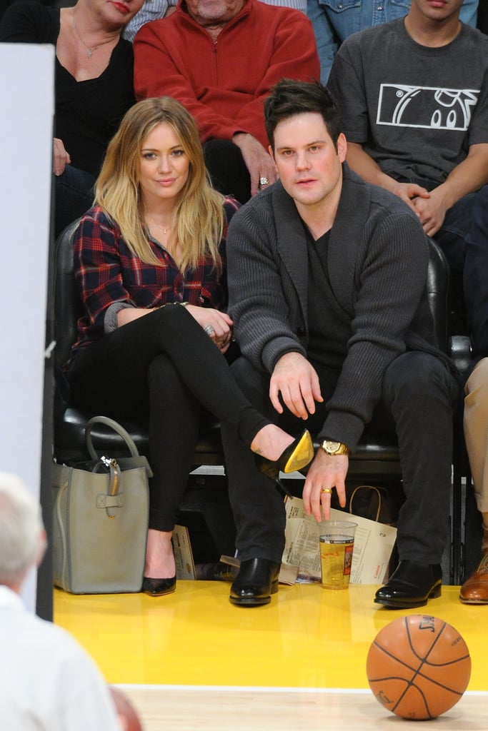 Hilary Duff kept cozy in a plaid flannel top and black skinny denim, then added black pointed pumps and a gray Céline luggage tote for a polished finish.
