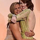 Jennifer wrapped her arms around Emma Stone on the Oscars red carpet in February 2015.