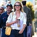 Candice Swanepoel lent a retro touch to her white button-down and jeans via black cat-eye sunglasses. Add these Tom Ford Nikita sunglasses ($360) to your mix to retro up your closet.