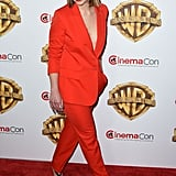 Emilia Clarke Wore a Red Suit on the CinemaCon Red Carpet