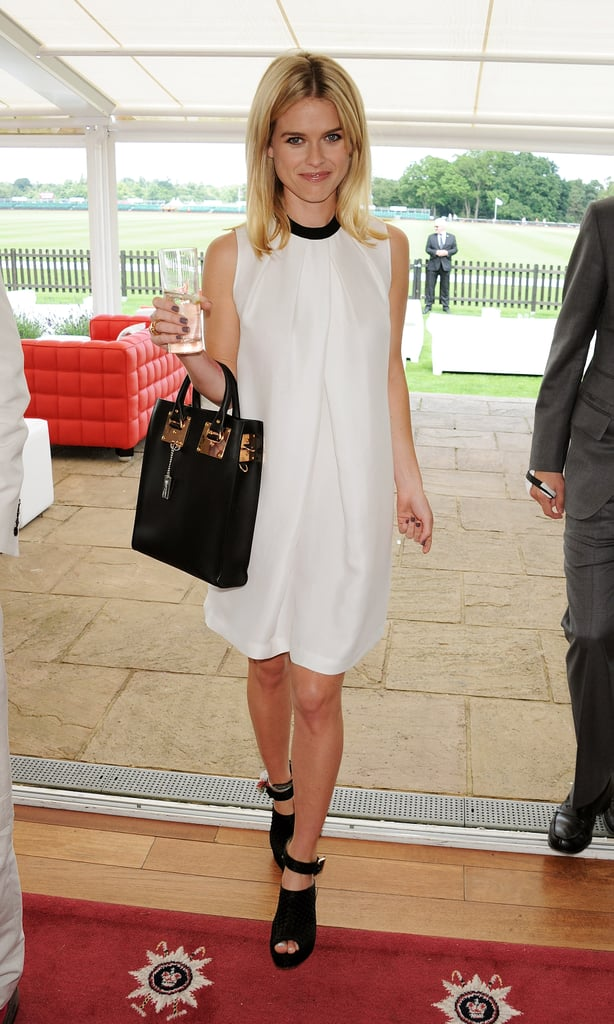 Alice Eve perfected chic day dressing in a crisp LBD and open-toe booties at the Guards Polo Cup.
