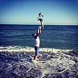 Stephen tossed his daughter into the air when they were at the beach in May 2015.