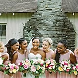 This smiley group of bridesmaids all wore the same pink dress.