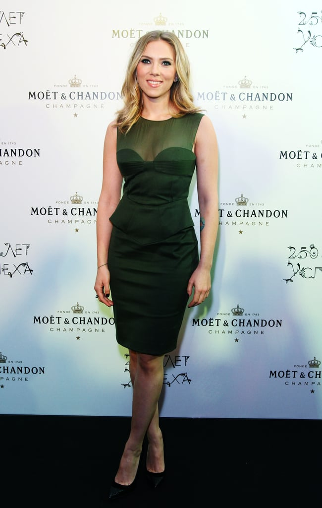 Scarlett Johansson wore a green Emilio Pucci dress last night to attend Moët & Chandon's 250th Anniversary party in Moscow. Before heading into the bash, she posed for pictures with the CEO of Moët Hennessy Russia, Frank Floc'hlay. As the face of the Champagne brand, Scarlett's traveled the world for promotional events since linking up with them back in 2009. More recently, Scarlett's been hanging out in Paris with boyfriend Nate Naylor and even making the rounds at a few Fashion Week parties.  Next up, Scarlett's returning to NYC for a return to Broadway in Cat on a Hot Tin Roof. Movies will keep her busy, too — she's prepping for next month's release of Hitchcock, which is out on Nov. 23 and costars Anthony Hopkins, Helen Mirren, and Jessica Biel. New reports suggest that Scarlett's Black Widow character may even appear in the upcoming Marvel sequel Captain America: The Winter Soldier.
