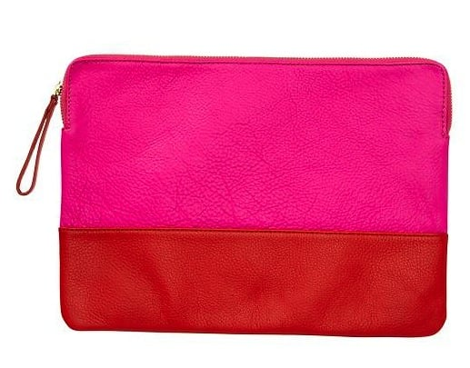 Bright, two-toned, and made of supersoft leather that could easily make you think you've actually owned this cool Gap clutch ($40) for seasons.