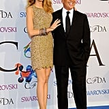 Designer Michael Kors doesn't stand quite as tall as a high-heeled Lively.