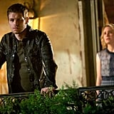 Klaus looks angry as Cami (Leah Pipes) turns up behind him.