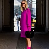 Go For a Monochrome Look With a Purple Dress and Matching Sock Boots