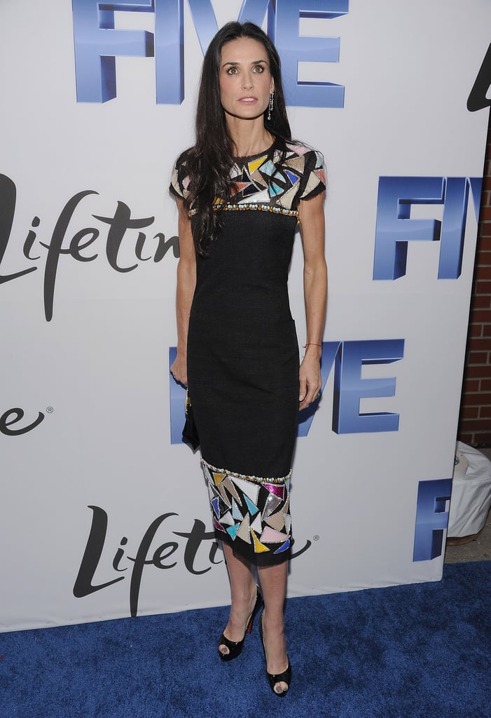 Showing off a chic, color-injected Chanel sheath at the Five NY screening in 2011.