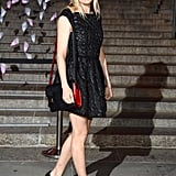 Sienna Miller stepped out at Vanity Fair's Tribeca Film Festival party in a floral-eyelet-detailed LBD, bejeweled black heels, and a cool red and black Madame satchel by Delvaux.