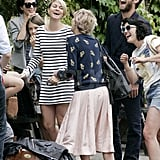 Jude Law laughs with friends after Kate Moss's wedding.