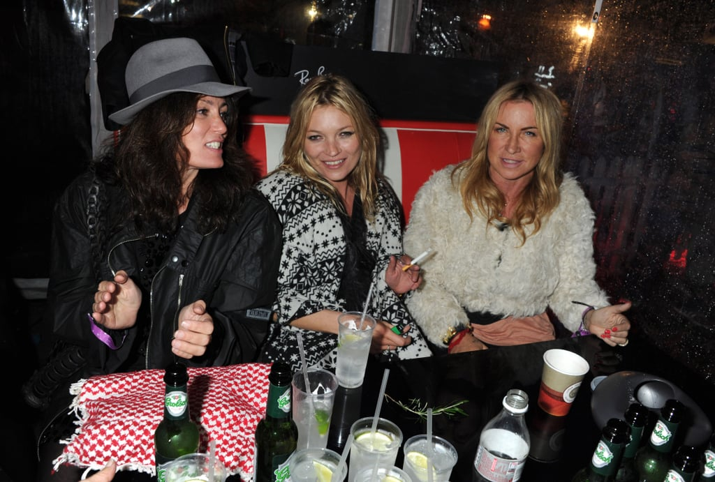 """Kate Moss gathered her best girlfriends together Friday and left London for a few days at the Isle of Wight Festival. The supermodel along with pals like Jade Jagger, Sadie Frost, Alison Mosshart, and Samantha Morton arrived at the music event Friday and proceeded to spend quality time together in the private Ray-Ban Room. The girls arrived in a pair of pink Hummers, which was the beginning of the fun Kate planned with a Big Fat Gypsy Wedding theme —they were also apparently wearing matching velour sweatsuits that said """"Kate's Hen Do."""" They hit the fairground area and were driven around backstage while acts like Kings of Leon, Foo Fighters, and Iggy Pop took the stage. Somehow, they even drank a reported 120 bottles of Mahiki rum. Kate, though, stayed at her rented cottage near the grounds on Saturday for some reason. Jamie Hince, meanwhile, got his boys together for a few days in St. Tropez to let loose at the Les Caves Du Roy nightclub. He was spotted enjoying an al fresco lunch at Le Club 55 yesterday before leaving in a helicopter."""