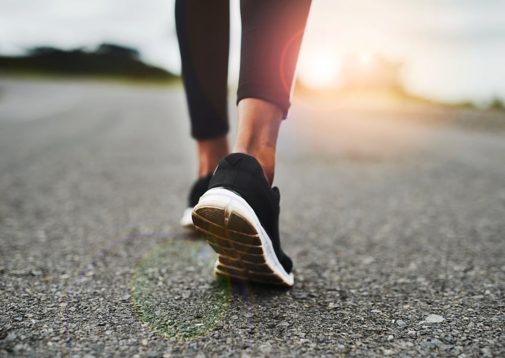 Here's How Often You'd Need to Walk to Start Burning Belly Fat, According to a Trainer