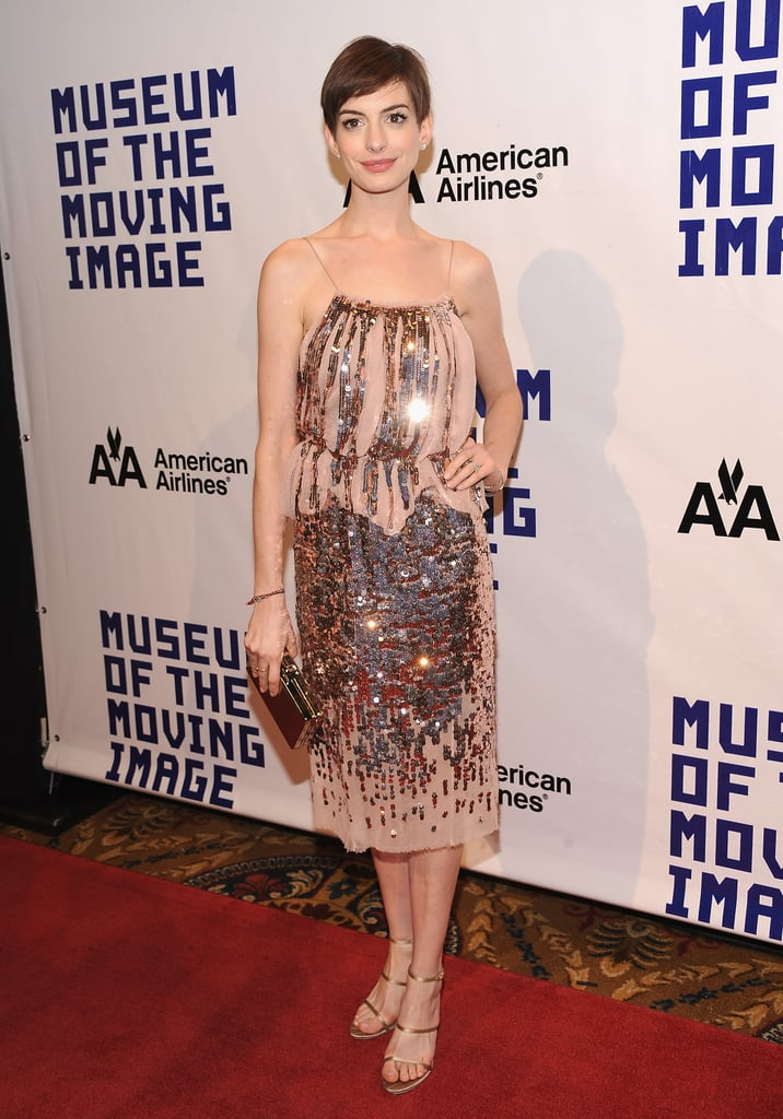 The brunette beauty styled a sequined Nina Ricci dress with gold Stella McCartney shoes and a mirrored Jill Sander clutch for a Museum of the Moving Image event in December 2012.