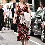 Make a summertime dress fit for fall with an ankle boot that carries more weight than your warm-weather sandal.
