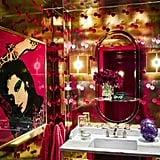 """Andy's bathroom might look straight out of a club, but that's because he's often entertaining an intimate circle of A-listers. Close friend Sarah Jessica Parker describes his house, saying, """"That flowered wallpaper, that yellow buffalo plaid on the couch, are so divinely Andy. They're whimsical but weighted in something grown-up. I sneak out to Andy's place when I have a half hour, and we'll have a drink and catch up."""""""