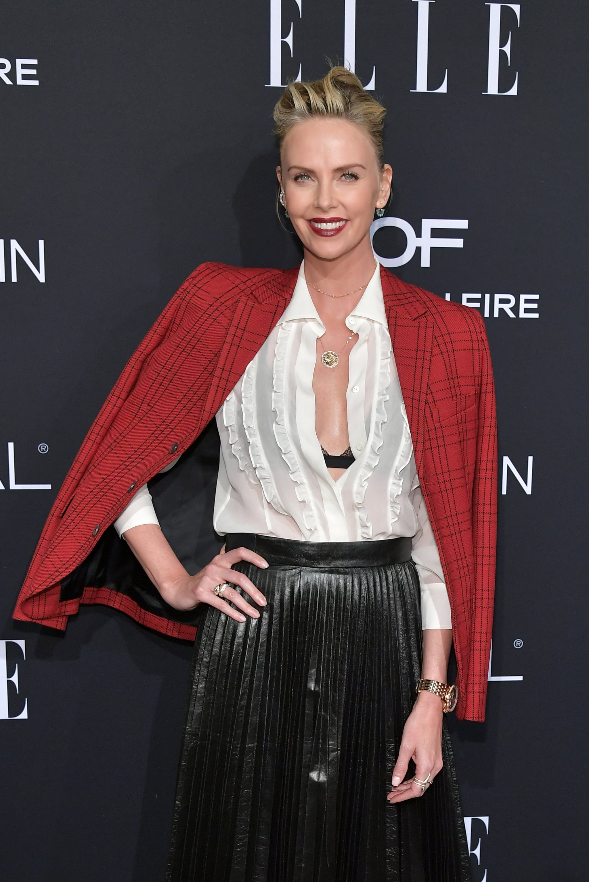 LOS ANGELES, CALIFORNIA - OCTOBER 15: Charlize Theron attends ELLE's 25th Annual Women In Hollywood Celebration presented by L'Oreal Paris, Hearts On Fire and CALVIN KLEIN at Four Seasons Hotel Los Angeles at Beverly Hills  on October 15, 2018 in Los Angeles, California. (Photo by Neilson Barnard/Getty Images for ELLE Magazine)