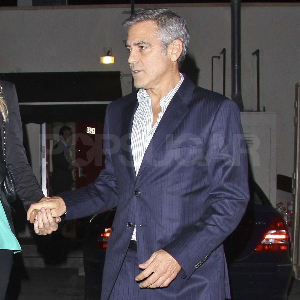 George Clooney in a blue suit.