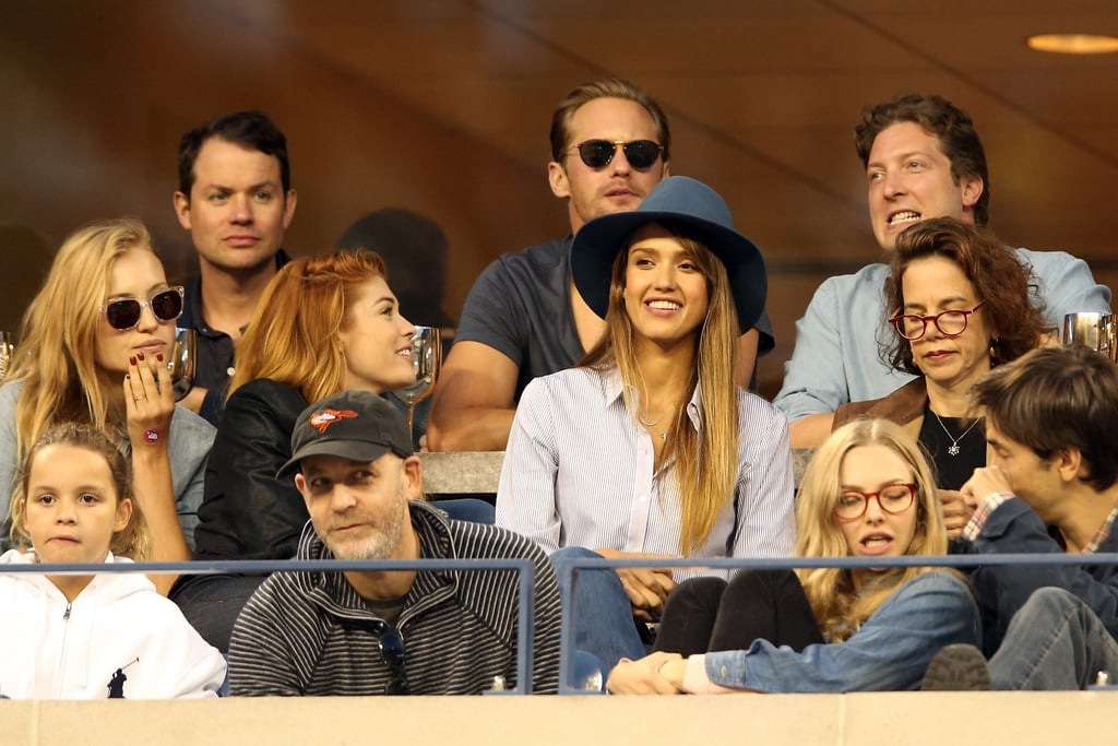 Jessica Alba matched a preppy, striped button-down with a navy wide-brim hat and jeans at the US Open tournament in NYC.