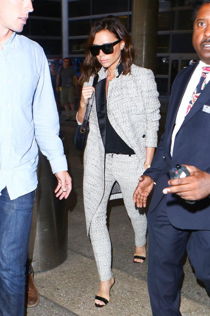 Victoria Beckham Wore a Tweed Suit, Black Tee, and Black Heels During Her Flight