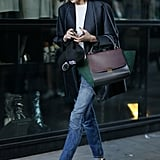 This classicist toted a Céline bag and hinted at an edgier style with a pair of cutout booties.