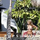 In February 2010, she flaunted her fit body in the pool in Mexico.