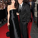 Amal wore a satin gown on the red carpet and finished her look with touches of gold to make her glow.