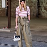 Paper-bag-waist pants and a striped tee offer an update on a staple Summer look.
