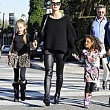 Heidi Klum kept her daughters, Leni and Lou, close for a family outing in LA on Sunday.