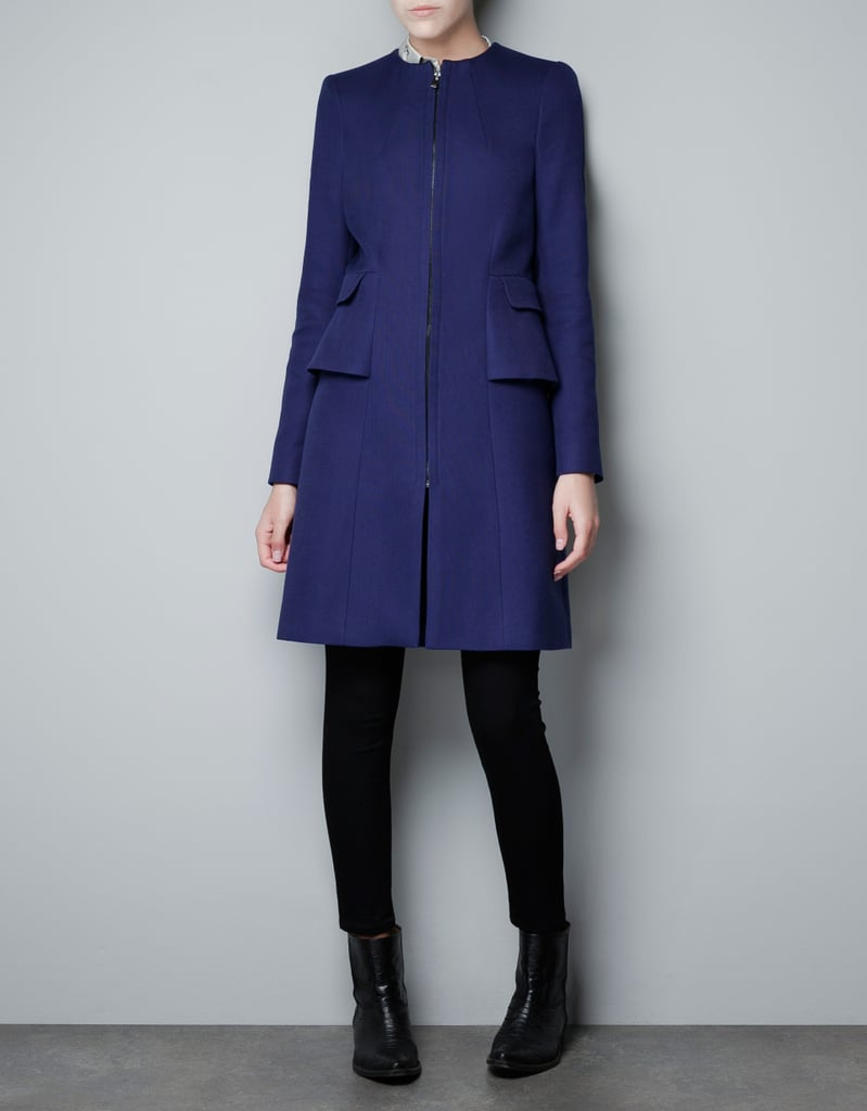 This Zara Structured Coat ($129) has a sharp tailored shape, but the peplum detail gives it a soft touch.