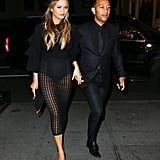 Chrissy kept the sexy factor going in a sheer look similar to her Zeynep Arcay's outfit while John wore a classic suit and pants combo.