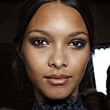 At Zuhair Murad, models wore a sultry smoky eye and middle-parted updo.