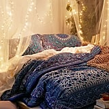 Make your bedroom merrier by draping lights from romantic mosquito netting.