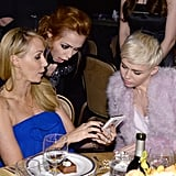 The Cyrus sisters — Miley and Brandi — looked immersed as their mom, Tish, showed them something on her phone.