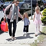 Jennifer Garner held Seraphina Affleck's hand as they picked Violet Affleck up from ballet class in LA.