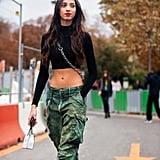 Style a camo pair with a crop top chain-link bag.