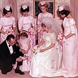 In their blush pink dresses and veils, these attendants in 1964 almost looked like they could be brides themselves.  Source: Flickr user mellicious