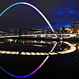 The Millennium Bridge glowed over the River Tyne in Newcastle upon Tyne, England.