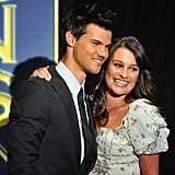Lea Michele put her arm around Taylor Lautner.