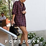 Miley Cyrus left her Miami hotel wearing black boots and a long plaid shirt.