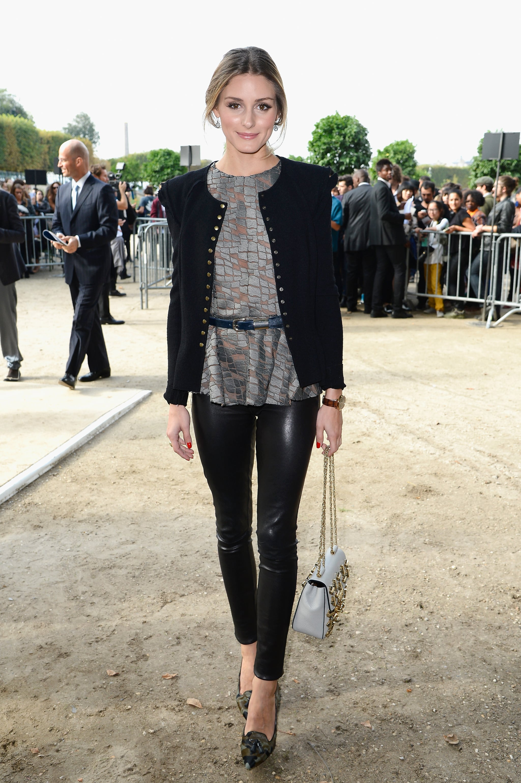 Olivia showed her glam-rock side at Elie Saab in a shimmering top, strong-shouldered jacket, and pair of ultraslick leather leggings.