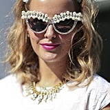 Show off your shades like this street styler, who pulled back her hair with a floral headband.