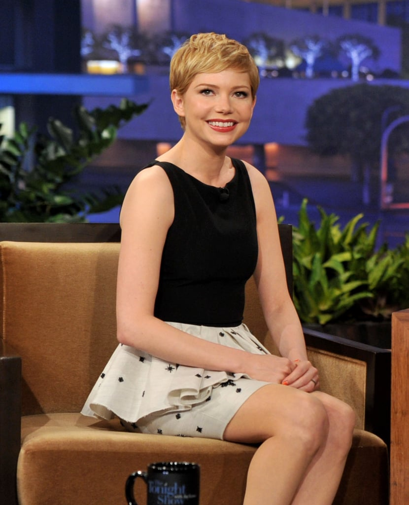 Michelle Williams in a white peplum skirt on a late-night talk show.