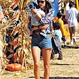 Alessandra Ambrosio took advantage of the LA weather and headed to a pumpkin patch in a pair of cool-girl cutoffs and a printed blouse.