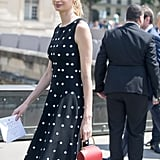What's more ladylike than a polka-dot dress with a top-handle bag?