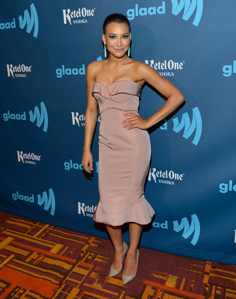 The ruffled hemline on Naya Rivera's dusty rose Zac Posen dress is darling. We appreciate the addition of green earrings, too. Re-create this sassy pairing for a glamorous evening affair.